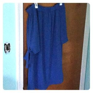 This is A light blue shoulder-less dress